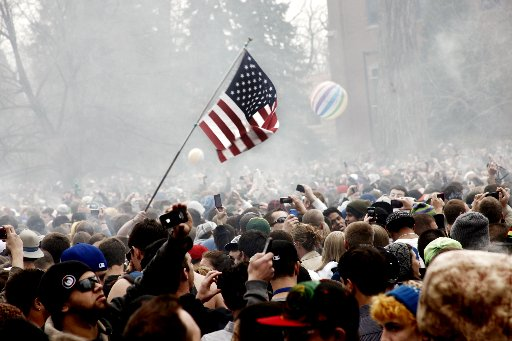 Smoke rises above thousands of people who gathered Wednesday for the 4/20 smoke out festival on the University of Colorado campus in Boulder April 20, 2011.
